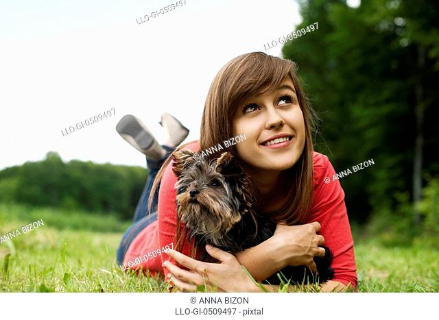 Young woman holding Yorkshire terrier Debica, Poland