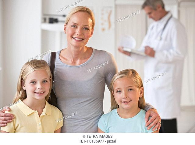Mother and daughters at Doctor's office