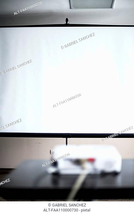 Blank projection screen in office or classroom