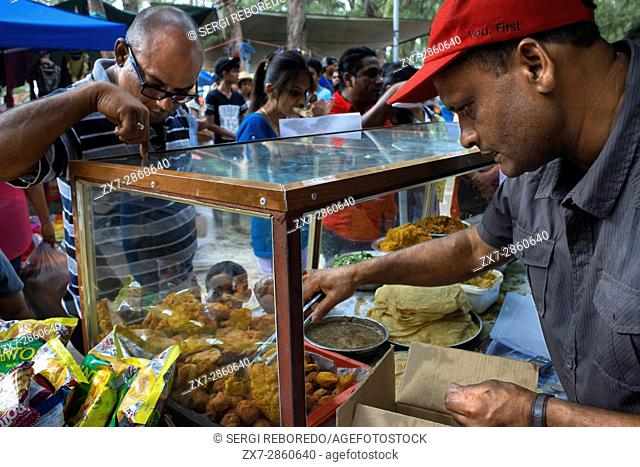 Hindu typical food during Ganga Snan (Asnan) Hindu, festival, Hindu families making puja on Belle Mare beach, Mauritius Island