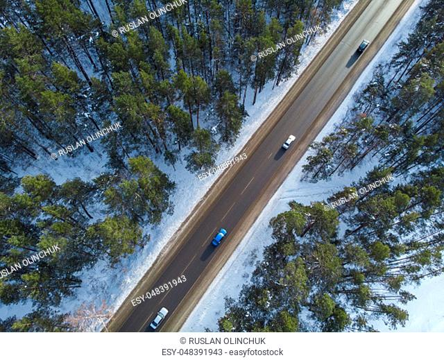 Aerial view of a road with traffic in winter landscape