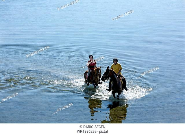 Couple Riding In The Sea, Croatia, Dalmatia, Europe