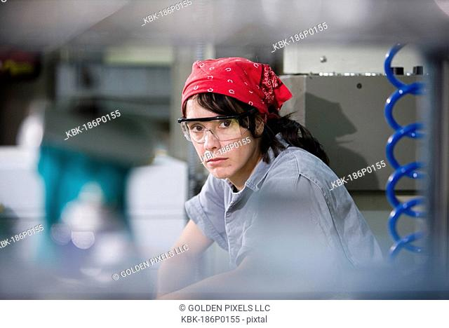 Portrait of a printing machine operator wearing safety goggles