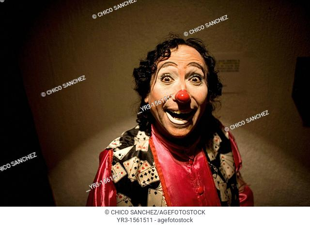 A clown smiles as he posses for a picture at the 16th International Clown Convention: The Laughter Fair organized by the Latino Clown Brotherhood