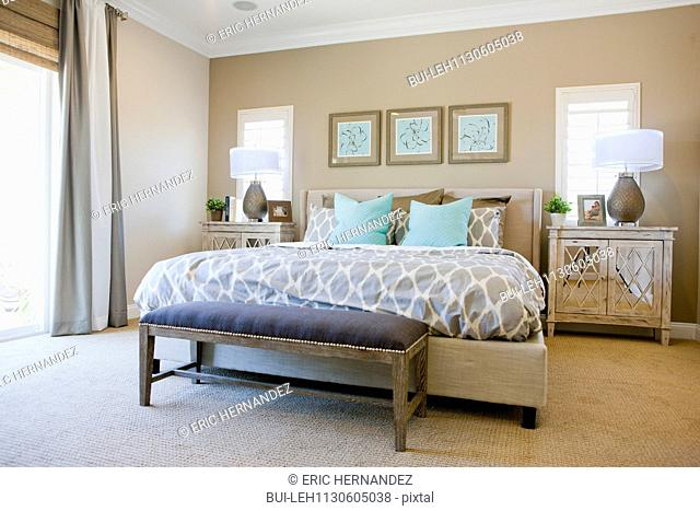 Interior of bed and foot stool in middle class house