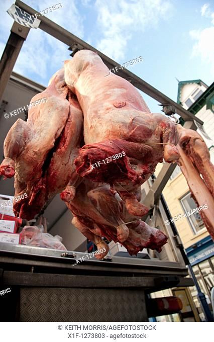 Fresh meat being delivered to a small family butcher, Aberystwyth Wales UK