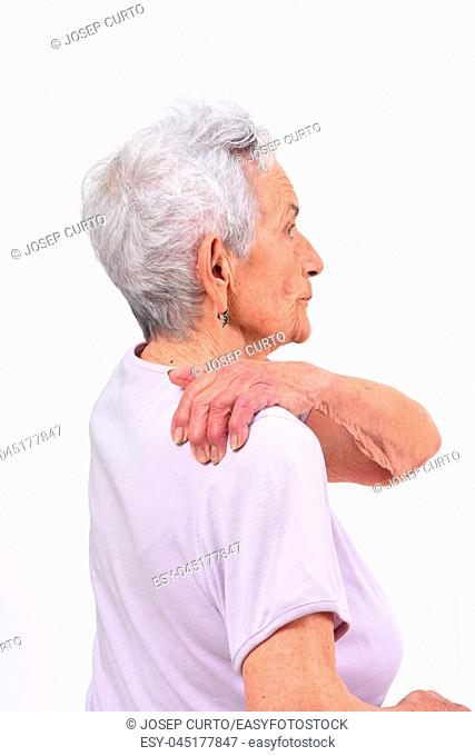 senior woman with pain on shoulder on white background
