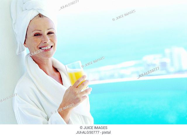 Woman with orange juice at spa