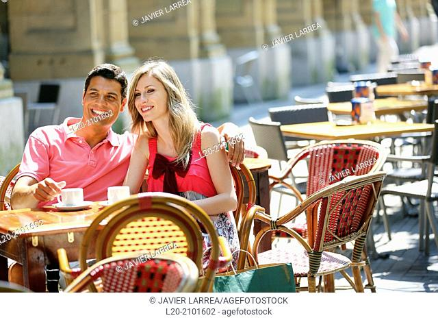Couple drinking coffee on a terrace. San Sebastian. Donostia. Gipuzkoa. Basque Country. Spain