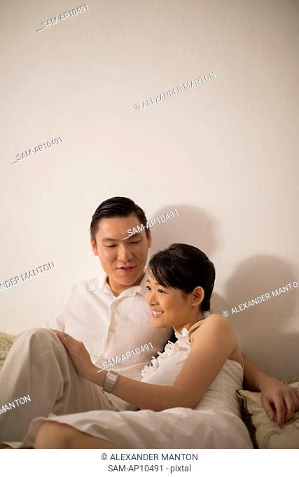 Singapore, Couple sitting on sofa