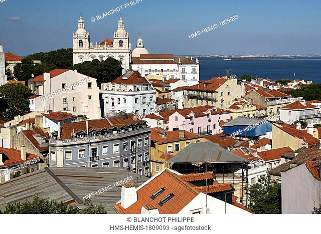 Portugal, Lisbon, view of Alfama District and Sao Vicente de Fora Monastery, Tagus River in the background