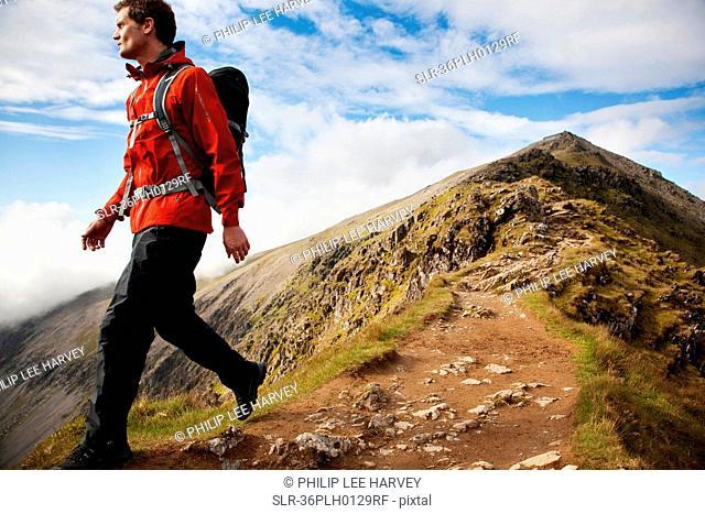 Hiker walking on rocky mountaintop