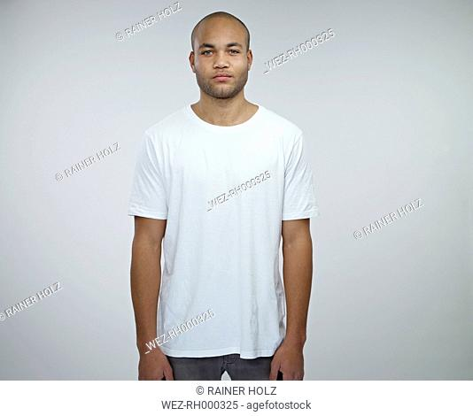 Portrait of young African man wearing white t-shirt