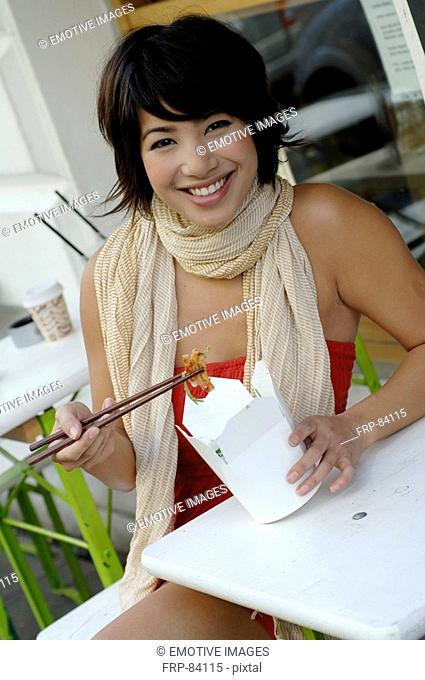 Girl eating asian food