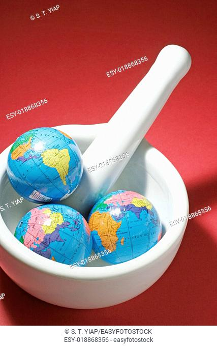 World globes in mortar and pestle
