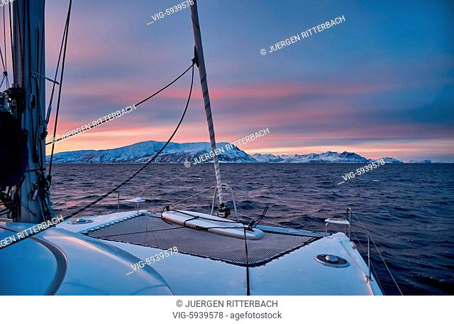 NORWAY, HANSNES, 01.11.2017, sunrise over fjord with winter landscape seen from sailship near Tromso, Troms, Norway, Europe - Hansnes, Troms, Norway, 01/11/2017