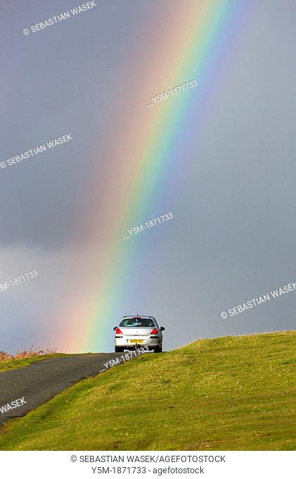 Rainbow over road near Cox Tor in the Dartmoor National Park, Devon, England, UK, Europe