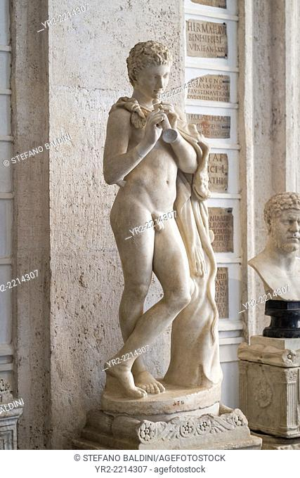 Ancient marble statue of young satyr with flute, gallery, Capitoline Museums, Rome, Italy