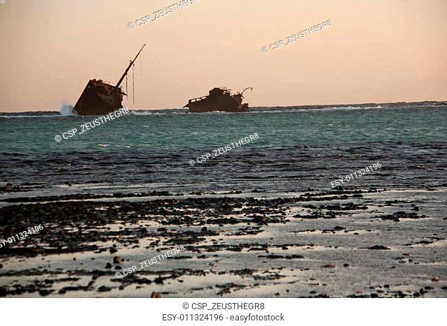 sinai desert and sea beach with sand and sun and ship wracked