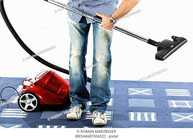Mature man fixing vaccuum cleaner