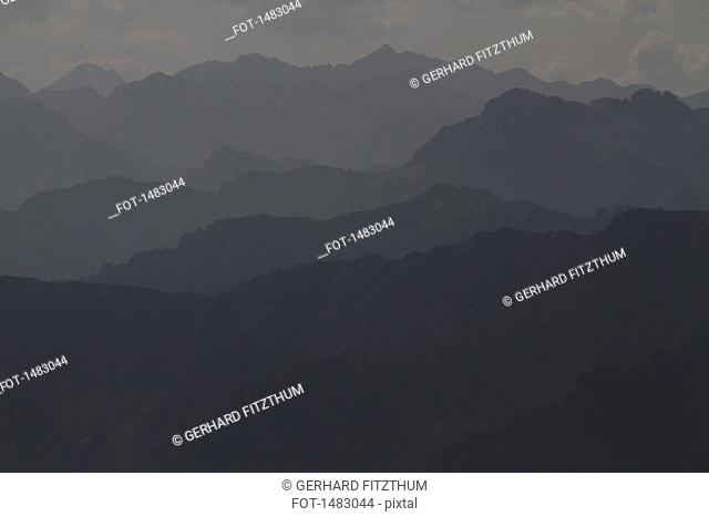 Scenic view of mountain range in foggy weather