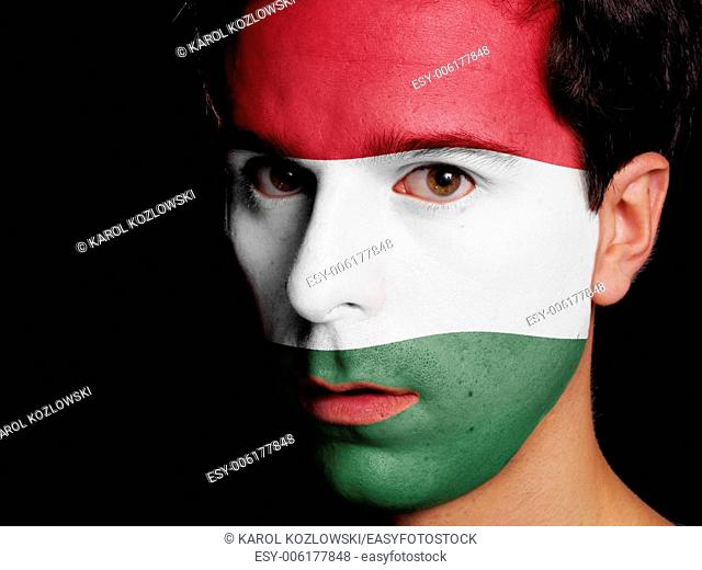 Flag of Hungary Painted on a Face of a Young Man