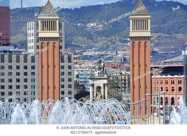 Close up of the Twin Venetian towers on Reina Maria Cristina Avenue through the water of the so called Magic Fountain in Montjuic Park