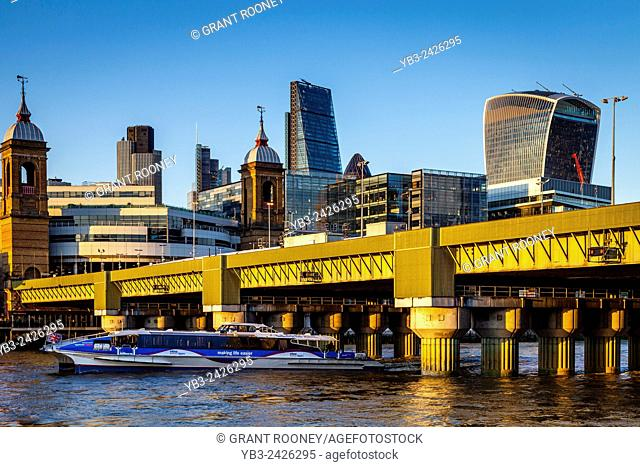 A Thames Clipper Passes Under The Cannon Street Railway Bridge, River Thames, London, England