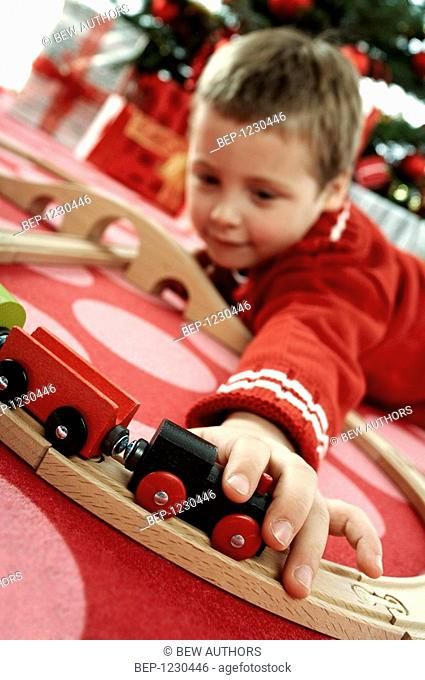 Little boy at christmas tree