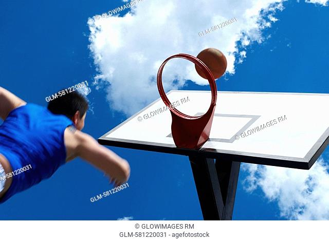 Low angle view of a basketball player shooting a goal