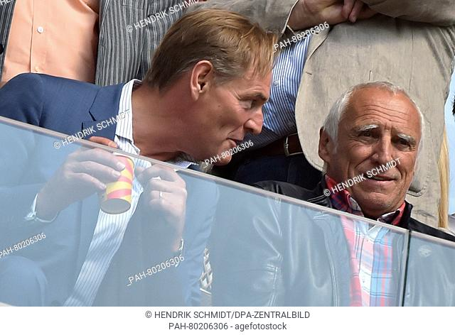 Leipzig's senior mayor Burkhard Jung (L) talks to Red Bull founder Dietrich Mateschitz at the German second division Bundesliga soccer match between RB Leipzig...
