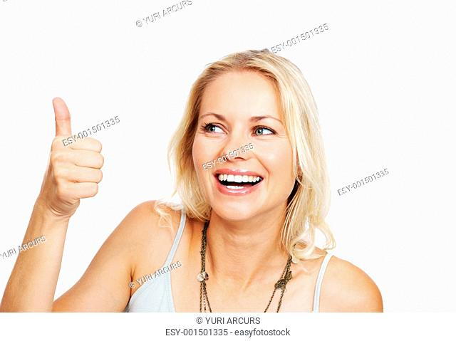 Closeup of cheerful young woman gesturing a thumbs up sign against white background
