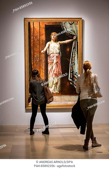 Two visitors look at the painting Clytemnestra (1852 , John Collier) at the Staedel Museum in Frankfurt am Main, Germany, 23 November 2016