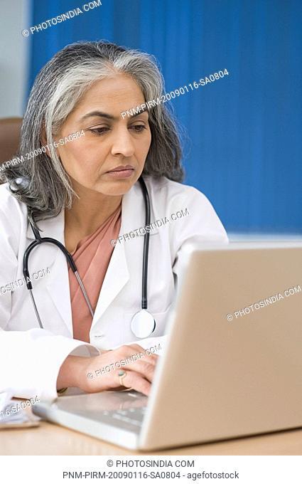 Female doctor using a laptop, Gurgaon, Haryana, India