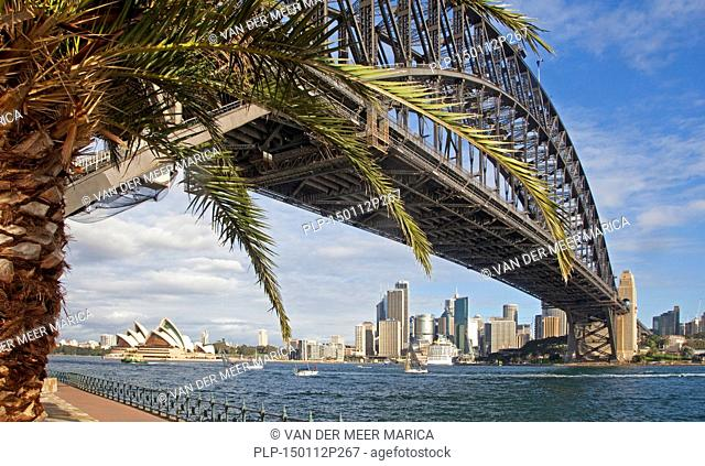 Sydney Harbour Bridge and view over the Sydney Opera House and skyscrapers of the the central business district / CBD, New South Wales, Australia