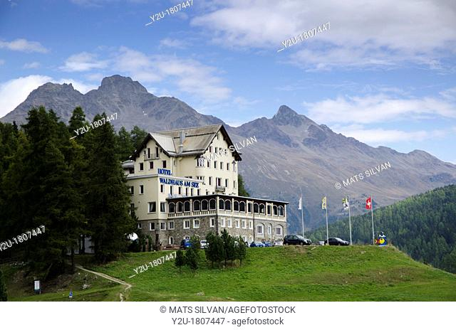 Hotel waldhaus am see in st Moritz and mountain and green trees with blue sky and clouds