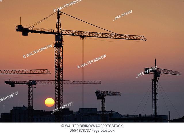France, Normandy Region, Manche Department, Cherbourg-Octeville, construction cranes, sunrise