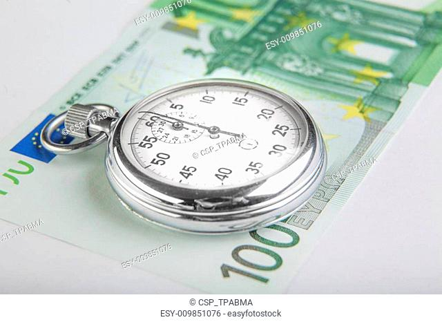 Stopwatch and a hundred euro banknote