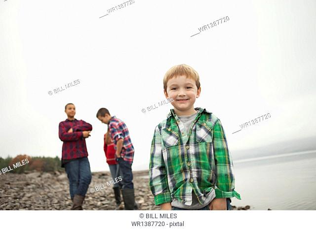 A day out at Ashokan lake. Three teenagers and a young boy on shore