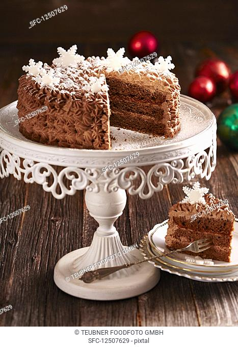 A festive rum-truffle cake with chocolate cream and fondant snowflakes