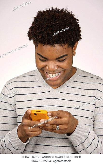 Young African-American man texting