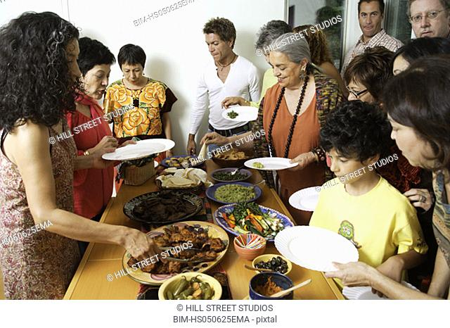 People eating at a buffet