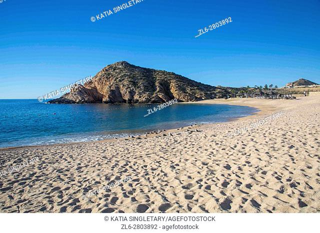 Empty beach in Cabos San Lucas, Baja California, Mexico. Ocean and mountains on a blue sky and sunny day