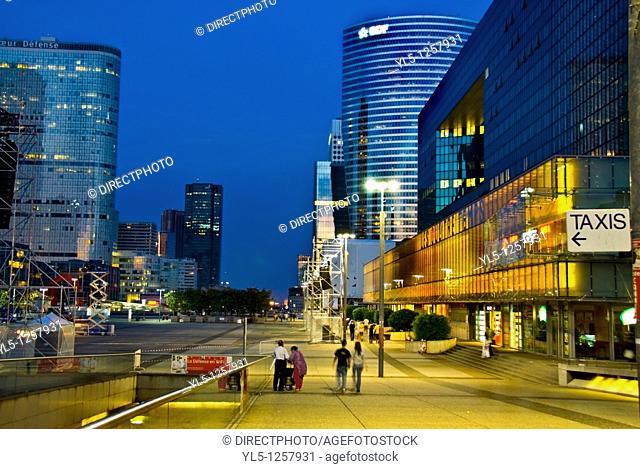 Paris, France- Commercial Architecture, La Defense Business Center, Street Scene Lit up at Night