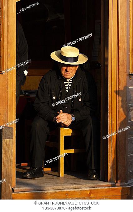 A Gondolier (Gondola Boatman) Waiting For Business, Venice, Italy