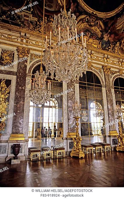 France, Versailles, Royal Palace, Hall of Mirrors, crystal chandeliers, gilt candelabras, painted ceiling, parquet wood floor