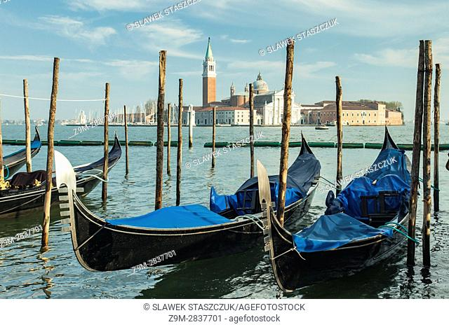 Gondolas at the sestier of San Marco, Venice, Italy. San Giorgio Maggiore church in the distance