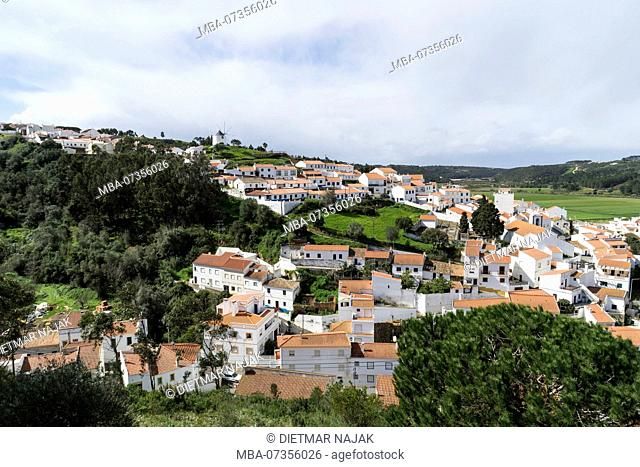 The small picturesque town of Odeceixe with its pretty town center near the wild rocky coastline on the Atlantic Ocean