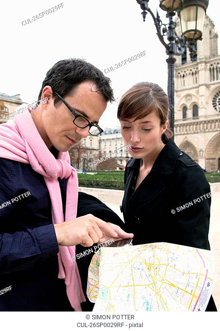 Couple check map in Paris