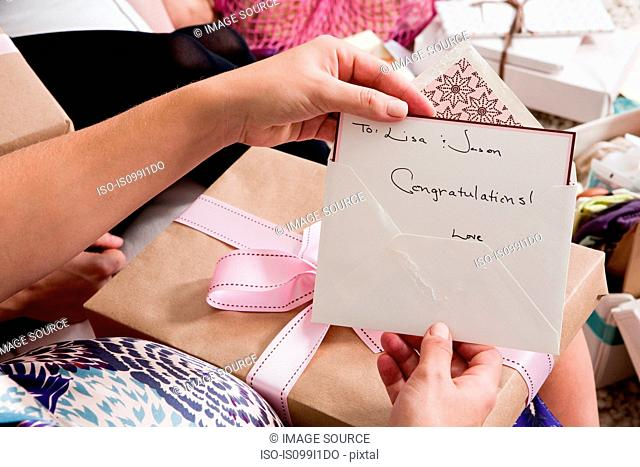 Woman holding up baby shower card
